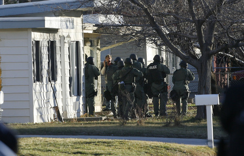 Francisco Kjolseth  |  The Salt Lake Tribune West Valley City police SWAT try to negotiate with an individual on a phone after evacuating a 2-3 block area surrounding 3150 S. Cantwell St. (2910 West), with the suspect who reportedly fired a gun during a standoff at a home.
