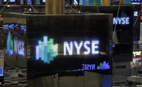 NYSE logos top trading posts on the floor of the New York Stock Exchange Thursday, Dec. 20, 2012. Shares in the company that runs the New York Stock Exchange are surging amid reports that it is in talks to sell itself to a rival stock exchange, Atlanta-based IntercontinentalExchange Inc. (AP Photo/Richard Drew)