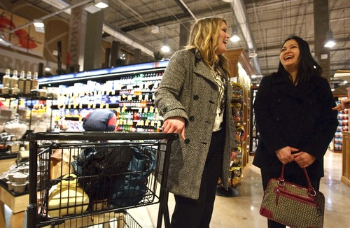Leah Hogsten  |  The Salt Lake Tribune Adrien Swenson and Evi Sayan talk about their shopping experience at the new Harmons.  The new Harmons grocery opened in downtown Salt Lake City Wednesday, February 15, 2012. The store at 100 S. 135 East was built on two levels. A 50,000-square-foot ground level features a large produce department and meat counter with fresh fish. On the 18,000-square-foot mezzanine there is a deli with a seating capacity for about 300 customers.
