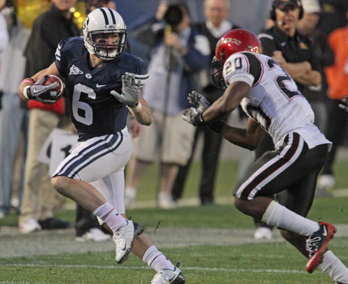 Rick Egan   |  The Salt Lake Tribune  McKay Jacobsen runs for the cougars, as Nate Berhe defends for the Aztecs, in football action,  BYU vs. San Diego State, game at Lavell Edwards Stadium in Provo,  Saturday, October 9, 2010