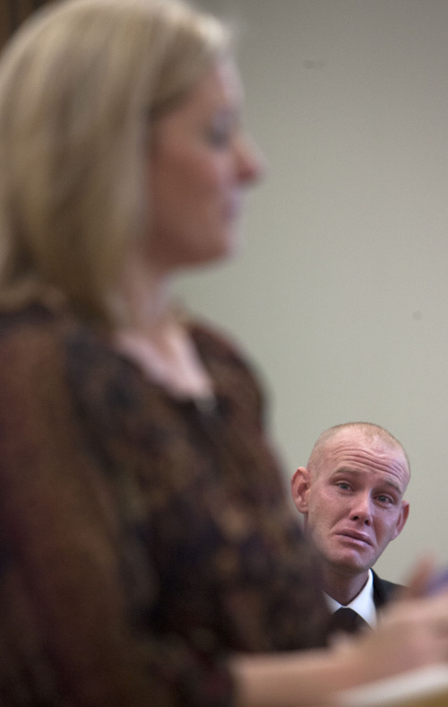 Steve Griffin | The Salt Lake Tribune  Choking back tears, Eric Charlton, who pled guilty to accidentally fatally shooting his brother in the head during a camping trip, listens with his attorney Susanne Gustin, as his mother, Linda Osiek, addresses the court during his sentencing hearing in 4th District Court in Nephi, Utah Thursday December 20, 2012.  I