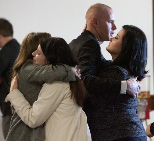Steve Griffin | The Salt Lake Tribune   Eric Charlton, who pled guilty to accidentally fatally shooting his brother in the head during a camping trip, his hugged by family and frounds following his sentencing hearing in 4th District Court in Nephi, Utah Thursday December 20, 2012.  I