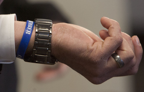 Steve Griffin | The Salt Lake Tribune   Eric Charlton, who pled guilty to accidentally fatally shooting his brother in the head during a camping trip, shows the blue bracelet he wears with his brother's name on it, following his sentencing hearing in 4th District Court in Nephi, Utah Thursday December 20, 2012.  I
