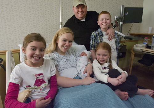 Steve Griffin | The Salt Lake Tribune  Dan and Angie Call with their newborn son, Jackson, and their daughters Natalie, 8, Kaylee, 5, and son, Josh, 11, at Altaview Hospital in Sandy, Utah Friday December 21, 2012.