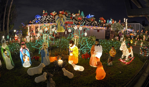 In this Thursday, Dec. 13, 2012 photo, Christmas lights decorate a home in the Los Feliz section of Los Angeles. (AP Photo/Mark J. Terrill)
