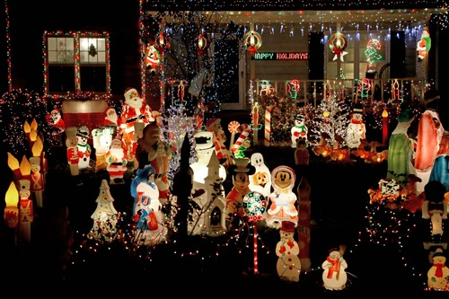 In this photo taken Tuesday, Dec. 11, 2012, various holiday figures and colored lights fill the yard of a home on Hawks Nest Court in Cary, N.C. (AP Photo/Gerry Broome)