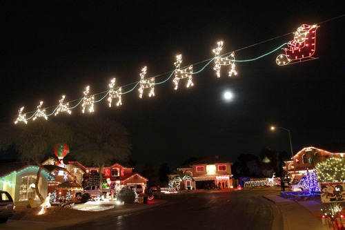 Christmas lights stretch across the street on Natal Circle Saturday, Dec. 1, 2012 in Gilbert, Ariz. (AP Photo/Matt York)