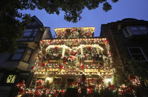 In this Tuesday, Dec. 4, 2012 photo, Christmas lights and ornaments adorn a house on Castro Street in San Francisco. (AP Photo/Jeff Chiu)