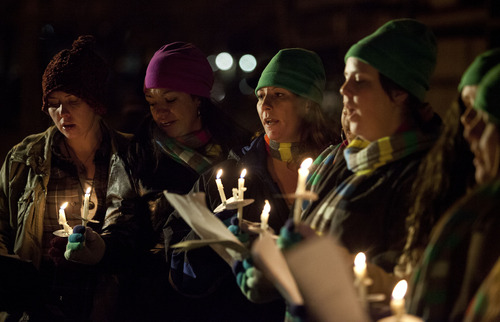 Lennie Mahler  |  The Salt Lake Tribune The House of Hope Choir sings during a candlelight vigil remembering the homeless people who have died and recognizing the struggles members of the homeless population face heading into Winter. The event, organized by the Fourth Street Clinic and the Salt Lake County Homeless Coordinating Council, was held at Pioneer Park and is part of a nationwide event on the eve of the Winter Solstice. Thursday, Dec. 20, 2012.