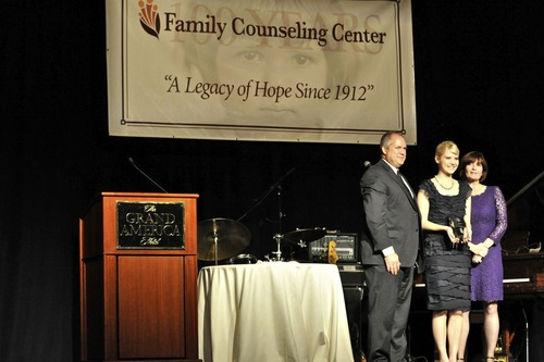 Robert Boyd, Chairman of the Board, Elizabeth Smart, Kate Della-Piana, Executive Director of the Family Counseling Center.  Photo by Kristin Stockham.