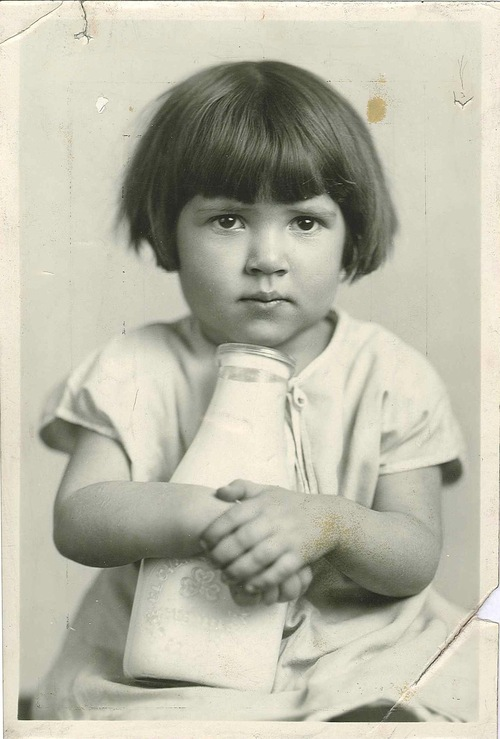 Courtesy   Family Counseling Center This little girl holds a bottle of milk received from the Charity Organization of Salt Lake. The agency's mission shifted over the years and eventually it became known as The Family Counseling Center.