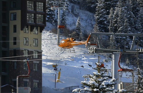 Scott Sommerdorf     The Salt Lake Tribune               A helicopter lands at the Canyons Ski Resort after searching the area of the avalanche near the Canyons in Park City, Wednesday, December 19, 2012.