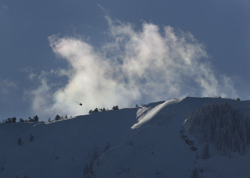Scott Sommerdorf     The Salt Lake Tribune               A helicopter flies over the area of the avalanche near the Canyons Ski Resort in Park City, Wednesday, December 19, 2012.  Summit County Sheriff Dave Edmunds said that at the time of his 2pm briefing, there were no skiers missing, or any presumed trapped.