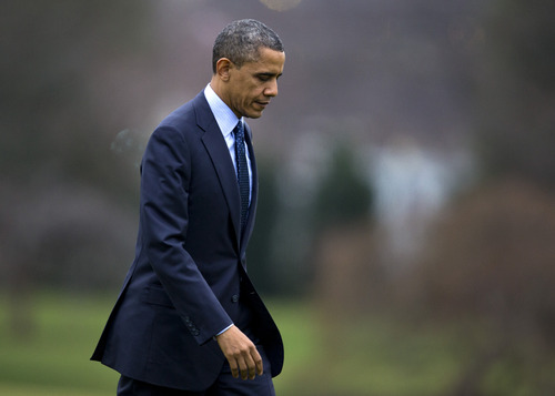 President Barack Obama walks from Marine One to the Oval Office of the White House, Thursday, Dec. 20, 2012, in Washington, as he returns from Walter Reed National Military Medial Center in Bethesda, Md., where he visited injured military members. (AP Photo/Carolyn Kaster)