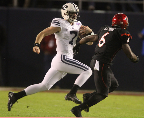 Rick Egan  | The Salt Lake Tribune   Brigham Young Cougars quarterback James Lark (7) runs the ball, San Diego State Aztecs defensive back Gabe Lemon (6) defends,  in football action during the Poinsettia Bowl, BYU vs. San Diego State, Thursday, December 20, 2012.