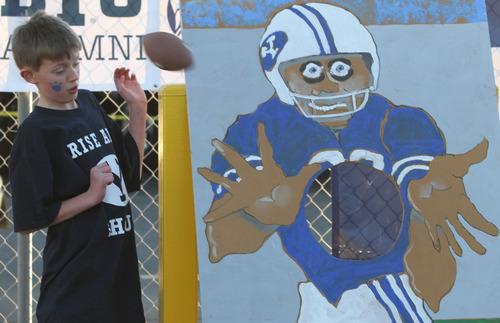 Rick Egan  | The Salt Lake Tribune   Nine-year-old Jake Mullins, Seattle, Washington, dodges a football, at the football toss, before the Poinsettia Bowl football game, BYU vs. San Diego State, Thursday, December 20, 2012.