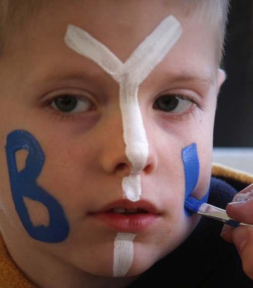 Rick Egan  | The Salt Lake Tribune   Six-year-old Aaron Jensen, Vancouver, Washington, gets his face painted on her face before the Poinsettia Bowl football game, BYU vs. San Diego State, Thursday, December 20, 2012.