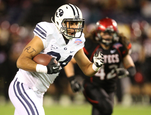 Rick Egan  | The Salt Lake Tribune   Brigham Young Cougars tight end Devin Mahina (84) runs after a big catch with just 9 seconds left in the half,setting up BYU's only score of the game so far,  in football action during the Poinsettia Bowl, BYU vs. San Diego State, Thursday, December 20, 2012.
