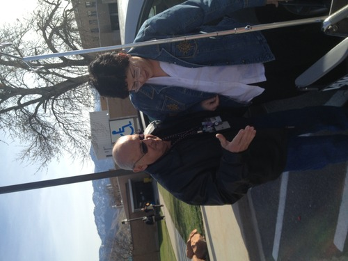 Sanford Rosenthal helps Army Veteran Diana Trujillo from her car into a wheelchair. Rosenthal, a veteran himself, has been volunteering with the Veterans Affairs Salt Lake City Health Care System for about 30 years.
