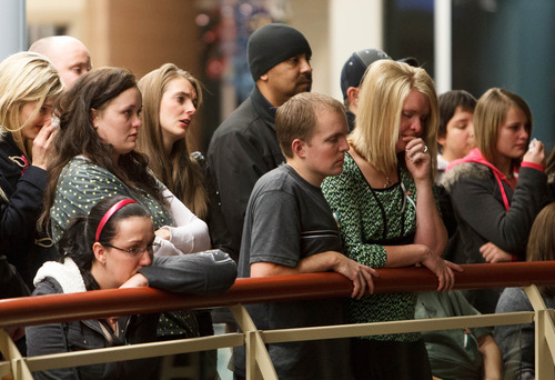 Trent Nelson  |  The Salt Lake Tribune Attendees listen as Robbie Parker speaks during a public memorial for his daughter, Emilie Parker, at Ben Lomond High School in Ogden, Thursday December 20, 2012. Parker was killed in the Sandy Hook Elementary School shooting.