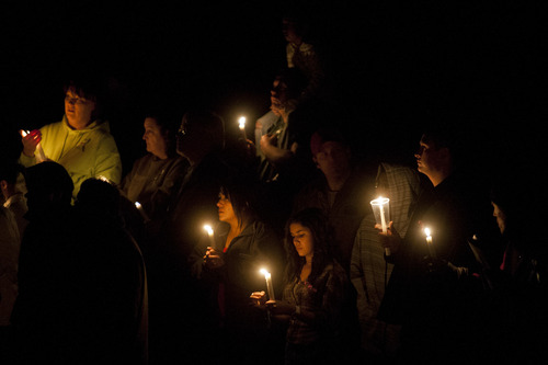 Chris Detrick  |  The Salt Lake Tribune Community members hold candles during a public service honoring Emilie Parker at at Ben Lomond High School in Ogden Thursday December 20, 2012.  Emilie was killed in last week's Sandy Hook Elementary School shooting.