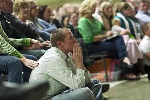 Chris Detrick  |  The Salt Lake Tribune Robbie Parker watches a slideshow of Emilie during a public service honoring his daughter Emilie Parker at at Ben Lomond High School in Ogden Thursday December 20, 2012.  Emilie was killed in last week's Sandy Hook Elementary School shooting.