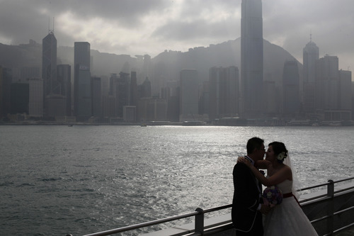 A couple poses for their wedding pictures in Hong Kong Friday Dec. 21, 2012. Many people around the world believe that the Mayan people predicted the end of the world Dec. 21. (AP Photo/Kin Cheung)