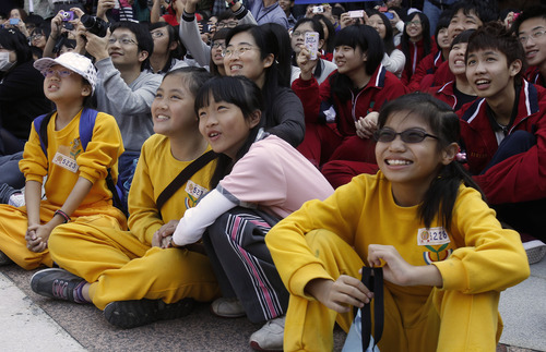Students watch during the countdown to when many believe the Mayan people predicted the end of the world, Friday, Dec. 21, 2012, in Taichung, southern Taiwan. (AP Photo/Wally Santana)