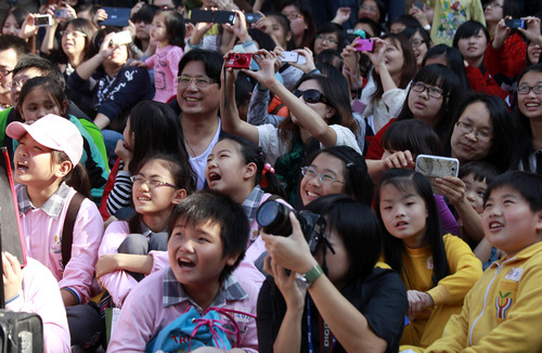 Students react during the countdown to when many believe the Mayan people predicted the end of the world, Friday, Dec. 21, 2012, in Taichung, southern Taiwan. (AP Photo/Wally Santana)