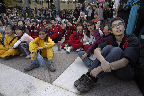 Students react during the countdown to when many believe the Mayan people predicted the end of the world, Friday, Dec. 21, 2012, in Taichung, southern Taiwan. the Mayas' 13th Baktun would officially end on this Dec. 21. (AP Photo/Wally Santana)