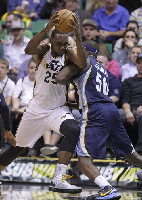 Memphis Grizzlies power forward Zach Randolph (50) defends against Utah Jazz center Al Jefferson (25)  who drives to the basket in the first quarter during an NBA basketball game on Saturday, Dec. 15, 2012, in Salt Lake City. (AP Photo/Rick Bowmer)