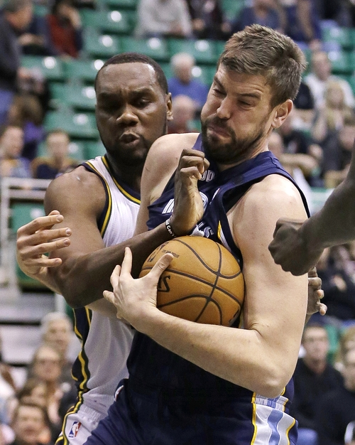Utah Jazz center Al Jefferson, left, looks on as Memphis Grizzlies center Marc Gasol, right, pulls down a rebound in the first quarter during an NBA basketball game on Saturday, Dec. 15, 2012, in Salt Lake City. (AP Photo/Rick Bowmer)
