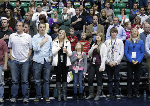 Fans look on during a moment of silence for the victims of the Connecticut school shootings before an NBA basketball game between the Utah Jazz and the Memphis Grizzlies, Saturday, Dec. 15, 2012, in Salt Lake City. (AP Photo/Rick Bowmer)