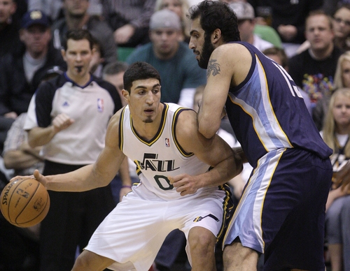Memphis Grizzlies center Hamed Haddadi (15), of Iran, defends against Utah Jazz center Enes Kanter (0), of Turkey, in the second quarter during an NBA basketball game on Saturday, Dec. 15, 2012, in Salt Lake City. (AP Photo/Rick Bowmer)
