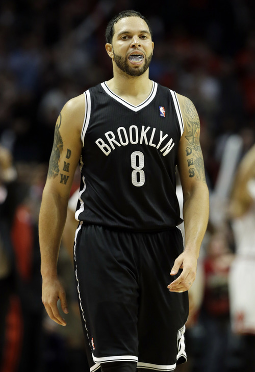 Brooklyn Nets guard Deron Williams reacts as he walks off the court after their 83-82 loss to the Chicago Bulls in an NBA basketball game in Chicago on Saturday, Dec. 15, 2012. (AP Photo/Nam Y. Huh)