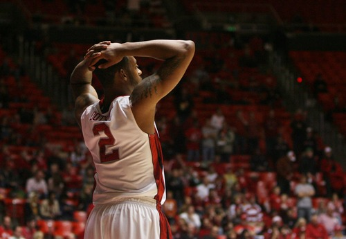Kim Raff  |  The Salt Lake Tribune University of Utah guard/forward Aaron Dotson (2) reacts to Cal State Northridge's comeback late in the fourth quarter during a game at the Huntsman Center in Salt Lake City on December 21, 2012.