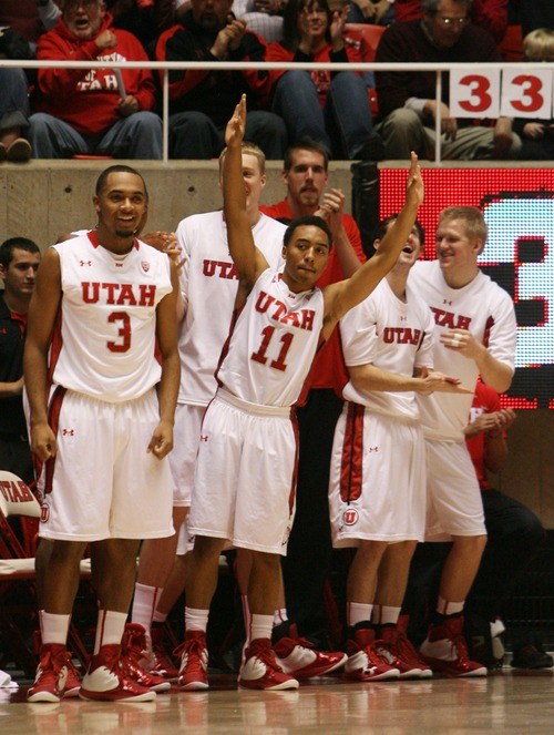 Kim Raff  |  The Salt Lake Tribune The University of Utah bench cheers a University of Utah forward Jordan Loveridge (21) makes a three pointer during a game at the Huntsman Center in Salt Lake City on December 21, 2012.