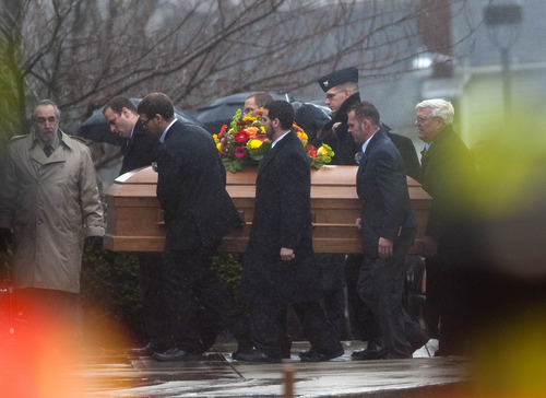 The casket for  Rachel D'Avino is carried into the Church of the Nativity in Bethlehem, Conn., on Friday Dec. 21, 2012.    D'Avino was killed when Adam Lanza walked into Sandy Hook Elementary School in Newtown, Conn., Dec. 14, and opened fire, killing 26 people, including 20 children, before killing himself.  (AP Photo/The Republican-American, Jim Shannon) MANDATORY CREDIT