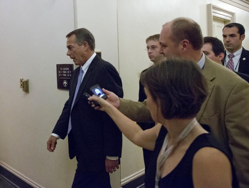 Speaker John Boehner of Ohio, center, departs, with reporters nearby after a House Republicans meeting on Capitol Hill, Thursday, Dec. 20, 2012 in Washington. Confronted with a revolt among the rank and file, House Republicans abruptly put off a vote Thursday night on legislation allowing tax rates to rise for households earning $1 million and up.(AP Photo/Alex Brandon)