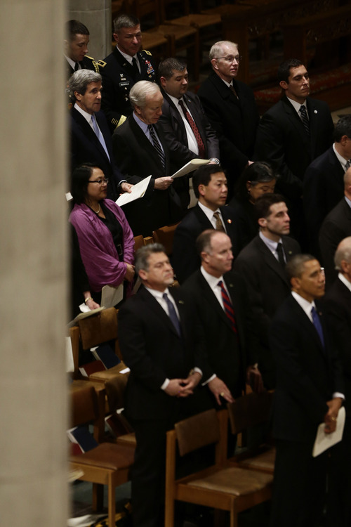 Sen. John Kerry, D-Mass., top left, is seated three rows behind President Barack Obama, bottom right, at the funeral service for the late Sen. Daniel Inouye, D-Hawaii, at the Washington National Cathedral, Friday, Dec. 21, 2012. (AP Photo/Charles Dharapak)
