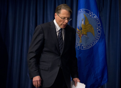 The National Rifle Association executive vice president Wayne LaPierre walks off after making a statement during a news conference in response to the Connecticut school shooting on Friday, Dec. 21, 2012 in Washington.  The National Rifle Association broke its silence Friday on last week's shooting rampage at a Connecticut elementary school that left 26 children and staff dead.  (AP Photo/ Evan Vucci)