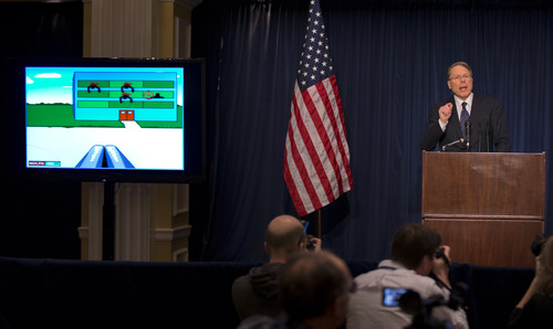 "The National Rifle Association executive vice president Wayne LaPierre gestures as he speaks about the violent online video game ""Kindergarten Killers"", left, during a news conference in response to the Connecticut school shooting on Friday, Dec. 21, 2012 in Washington.  The National Rifle Association broke its silence Friday on last week's shooting rampage at a Connecticut elementary school that left 26 children and staff dead. (AP Photo/ Evan Vucci)"