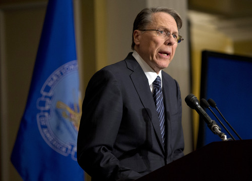 "The National Rifle Association executive vice president Wayne LaPierre, speaks during a news conference in response to the Connecticut school shooting on Friday, Dec. 21, 2012 in Washington.  The nation's largest gun-rights lobby is calling for armed police officers to be posted in every American school to stop the next killer ""waiting in the wings."" (AP Photo/ Evan Vucci)"