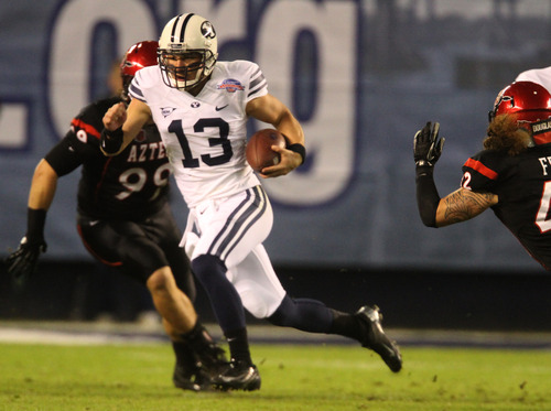 Rick Egan  | The Salt Lake Tribune     Brigham Young Cougars quarterback Riley Nelson (13) runs for a first down, in first half action in the Poinsettia Bowl, BYU vs. San Diego State, Thursday, December 20, 2012.