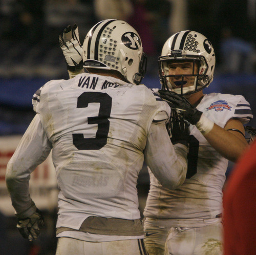 Rick Egan  | The Salt Lake Tribune   Brigham Young Cougars defensive back Daniel Sorensen (9) celebrates with Brigham Young linebacker Kyle Van Noy (3) after he scored a touchdown for cougars, on an intercepted pass, as BYU defeated San Diego State 23-6 in the Poinsettia Bowl, Thursday, December 20, 2012.