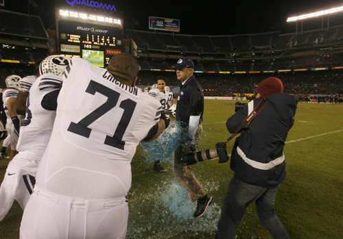 Rick Egan  | The Salt Lake Tribune    Brigham Young Cougars head coach Bronco Mendenhall avoids the gatorade dumped by Tui Crichton (71) as time runs out, as BYU defeats San Diego State in the Poinsettia Bowl, Thursday, December 20, 2012.