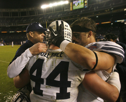 Rick Egan  | The Salt Lake Tribune   Brigham Young Cougars head coach Bronco Mendenhall  hugs Brigham Young Cougars linebacker Brandon Ogletree (44) and linebacker Spencer Hadley (2) near the end of the game, as BYU defeats San Diego State in the Poinsettia Bowl, Thursday, December 20, 2012.