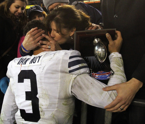 Rick Egan  | The Salt Lake Tribune   Brigham Young Cougars linebacker and most valuable defensive player, Kyle Van Noy (3), gets a kiss from his mother Kelly Van Noy,  after BYU defeated San Diego State 23-6 in the Poinsettia Bowl, Thursday, December 20, 2012.
