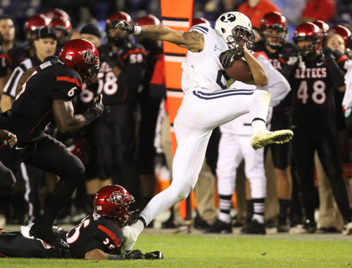 Rick Egan  | The Salt Lake Tribune   Brigham Young Cougars wide receiver Cody Hoffman (2) breaks a tackle by San Diego State Aztecs defensive back King Holder (35) as he runs down field for the Cougars, in the Poinsettia Bowl, Thursday, December 20, 2012.