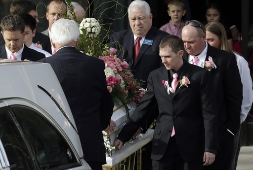 The casket of 6-year-old Emilie Parker is carried following funeral services on Saturday, Dec. 22, 2012, in Ogden, Utah. Emilie, whose family has Ogden roots, was one of the victims killed in a Dec. 14 mass shooting at Sandy Hook Elementary in Newtown, Conn. (AP Photo/Rick Bowmer)
